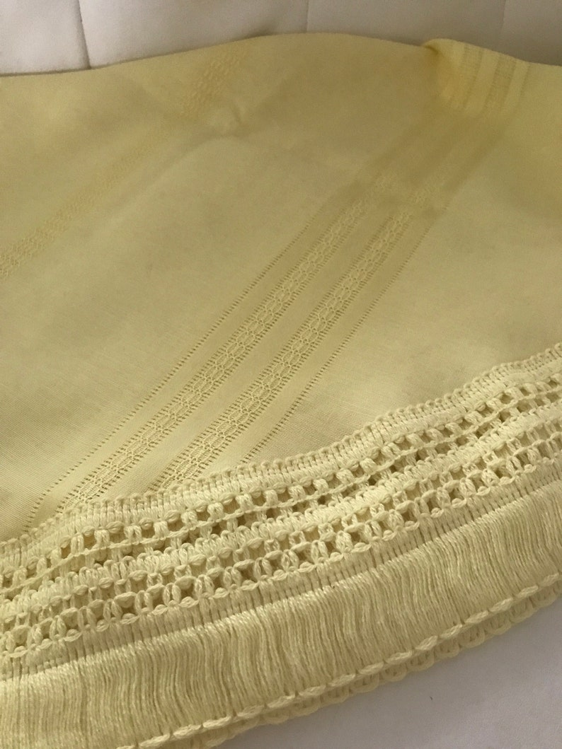Amazing soft yellow round vintage tablecloth with gorgeous crocheted trim
