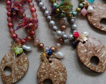 Long beaded crystal necklace and coconut pendant