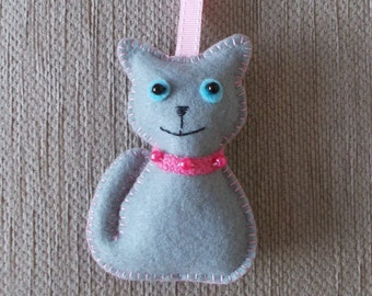A handmade grey felt cat hanging decoration