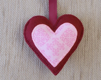A handmade burgundy felt love heart hanging decoration