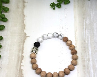 Handmade Rosewood and Howlite Buddha Aroma Diffuser Bracelet.