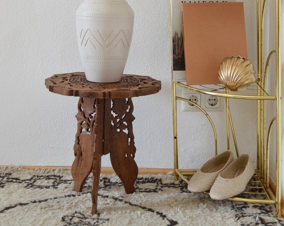 Vintage side table made of wood carving with boho