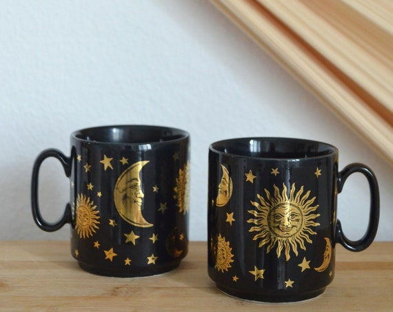 Set of two vintage cups sun moon stars black gold pottery