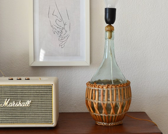 large vintage wine bottle table lamp in rattan and glass, beige, brown, mid century