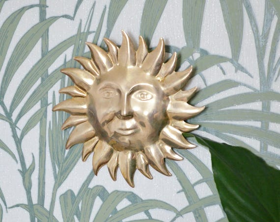 Vintage wall decoration sun face from brass boho
