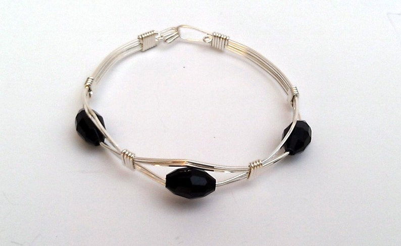 Sterling Silver Handcrafted Bracelet with Black Faceted Beads
