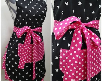 Multi-colored frostedsprinkled donuts on main Bright pink and pocket ties and frills. Women/'s apron Adult apron