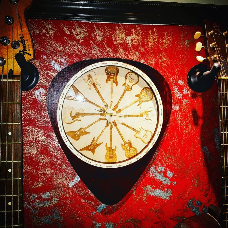 Custom Engraved Guitar Clock Mounted Inside A Wooden Cutout Guitar Pick Clock Is 12x12 And Pick Is 16x24