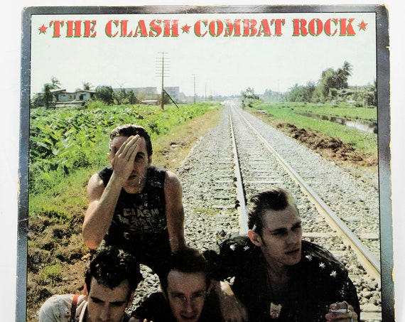 The Clash Combat Rock original first pressing vinyl record album with Combat labels with Innoculated City commercial