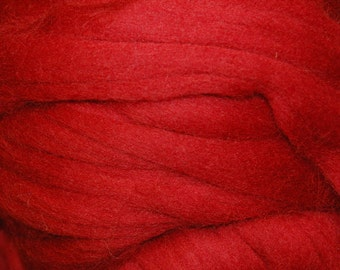 Cherry Red merino wool roving - 50g. Great for wet felting / needle felting, and hand spinning projects.
