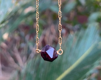 Garnet with triangular facets [grounding, safety, security, abundance]