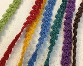 Bracelet crocheted with thin yarn, in many colors. Zoownatas