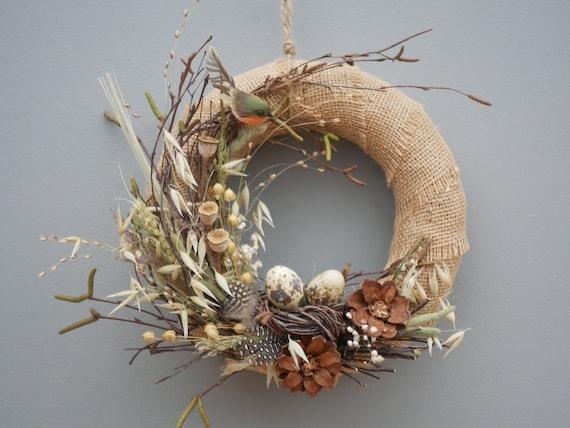 Spring wreath with bird to hang against a door