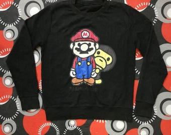 b24c4994 MARIO TO MILO sweatshirt copyright super mario character 2008 nov/ jumper /  pullover shirt