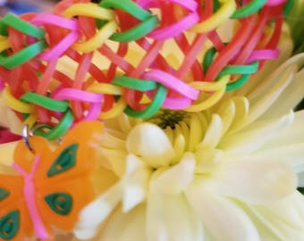 Pink, orange,green and yellow loom bracelet with butterfly charm