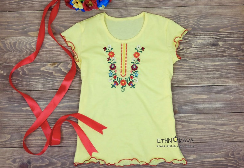 f4a3a304a161 Yellow bright embroidered t-shirt for girl 6-7 with