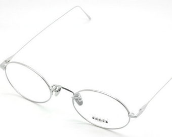 9455c9c158b Les Pieces Uniques CLOUD Titanium Oval Eye Glasses in Silver Finish