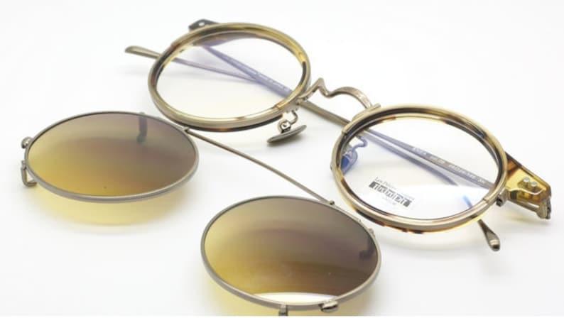 725ca327e57 Les Pieces Uniques ENEA Titanium Round Glasses Gold and Light