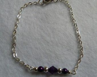 Silver bracelet with purple beads
