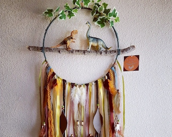 Dream catcher dinosaurs on branch with leaves and leather feathers