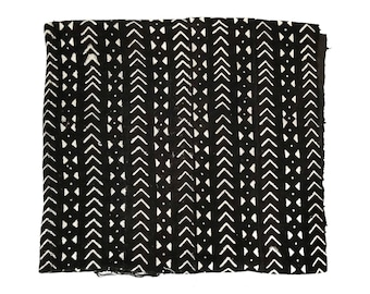 Black mudcloth fabric throw with arrow and dots print