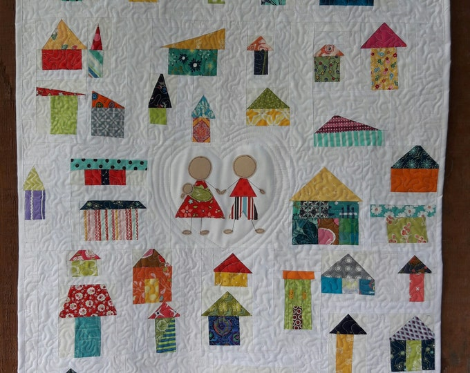 It Takes A Village, a free form, whimsical, pdf quilt pattern with houses and family