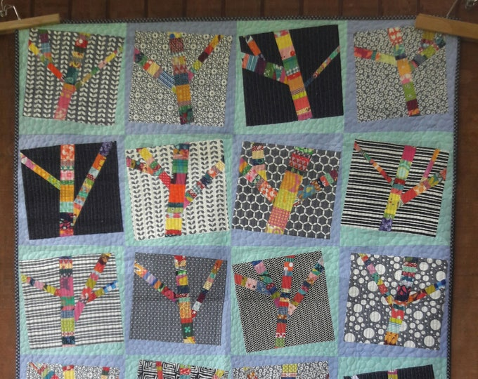 Yarn Bomb Trees- a improvisational, layer cake friendly, scrap quilt pdf pattern