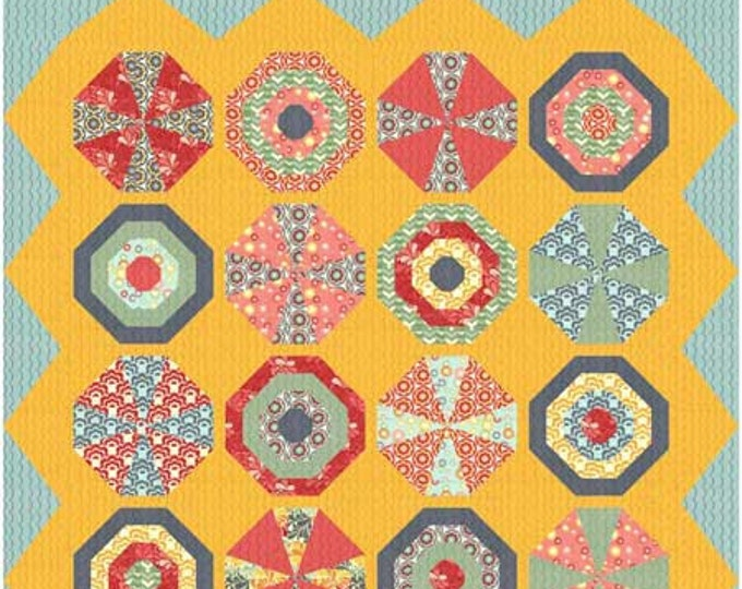 Beach balls and Umbrellas kaleidoscope blocks make up this beach quilt quilt pattern