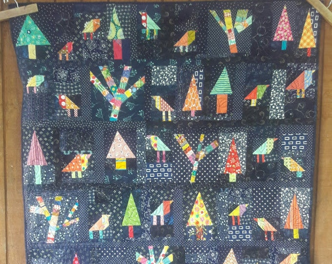 Enchanted Forest a whimsical, free form, scrap quilt PDF pattern of colorful birds and trees
