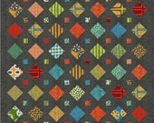 Treasures a pre-cut,  patchwork, scrap quilt pattern with multiple sizes