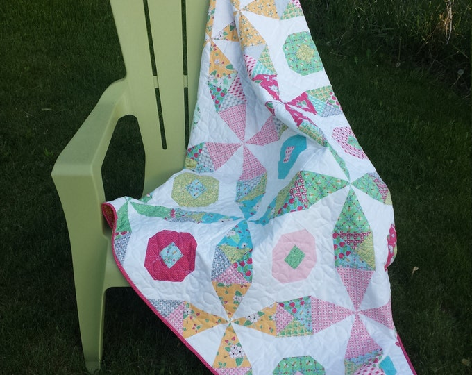 Beeline- kaleidoscope and snowball blocks combine in this quilt pattern