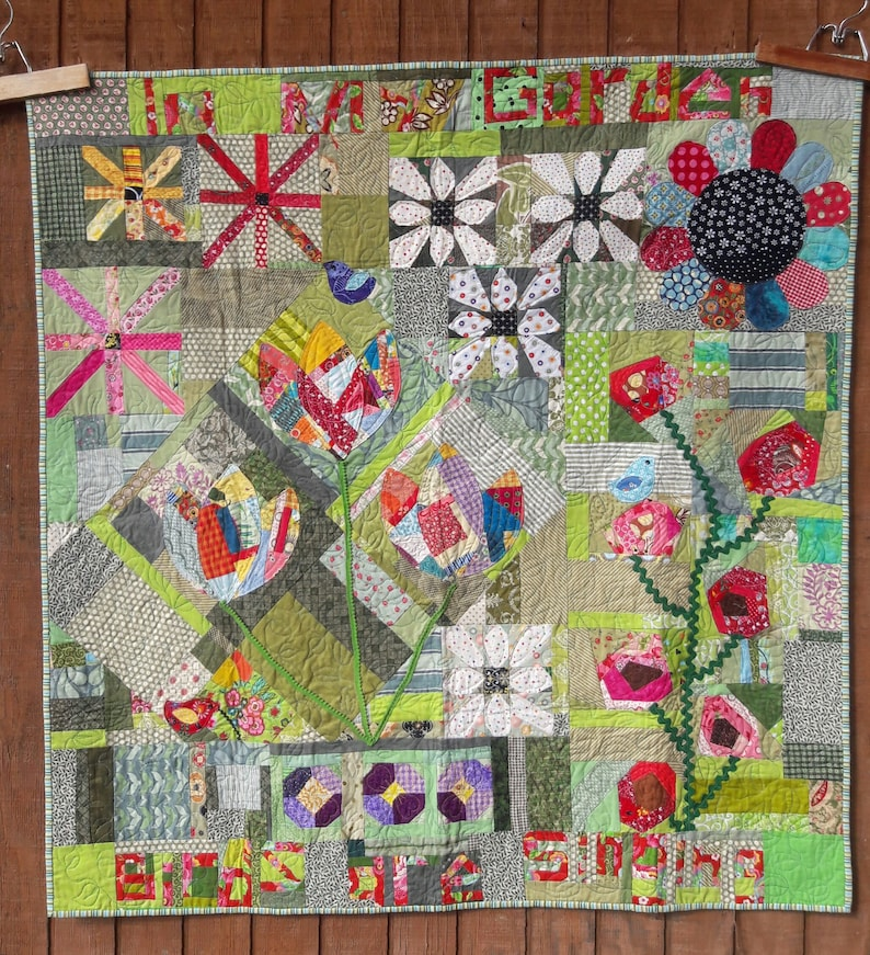 Naughty Garden scrappy free pieced quilt pattern image 0