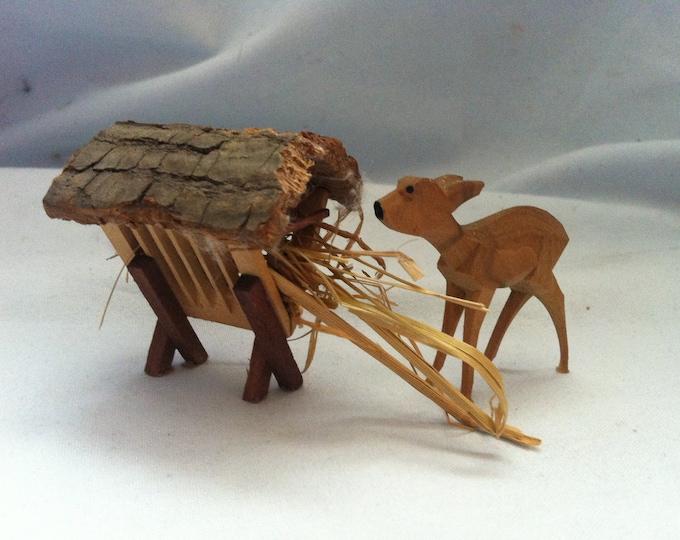 Vintage wood feeding crib with deer and hay