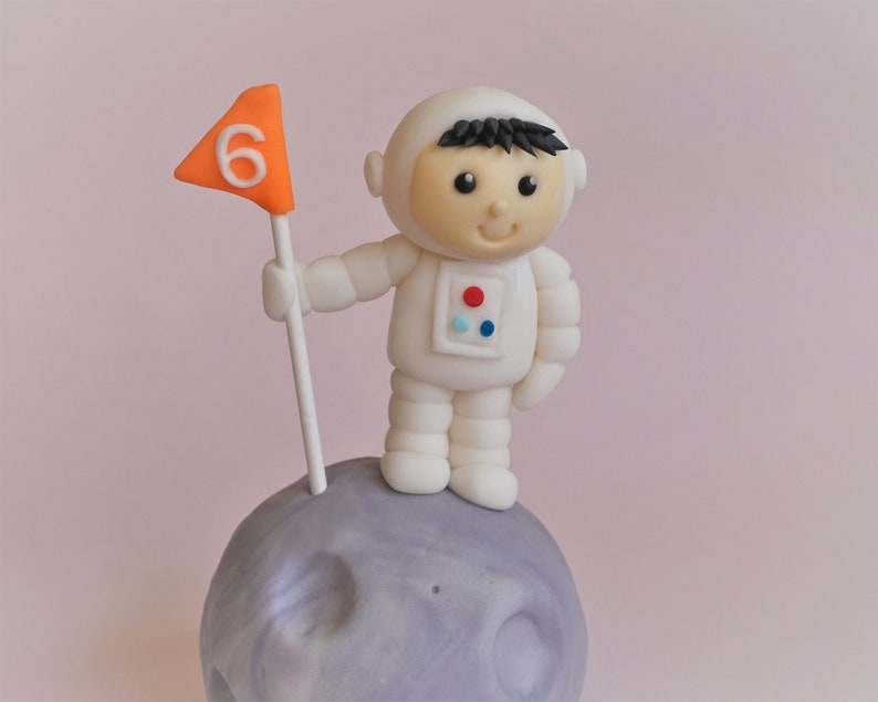 Fondant astronaut on a moon cake topper for space birthday image 0
