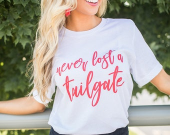 0d41da63d4ee Never Lost A Tailgate Graphic Tee..Match Your Team..Multiple Colors..Casual Tailgating  Tee..Football..Basketball..Baseball..Gameday Tee