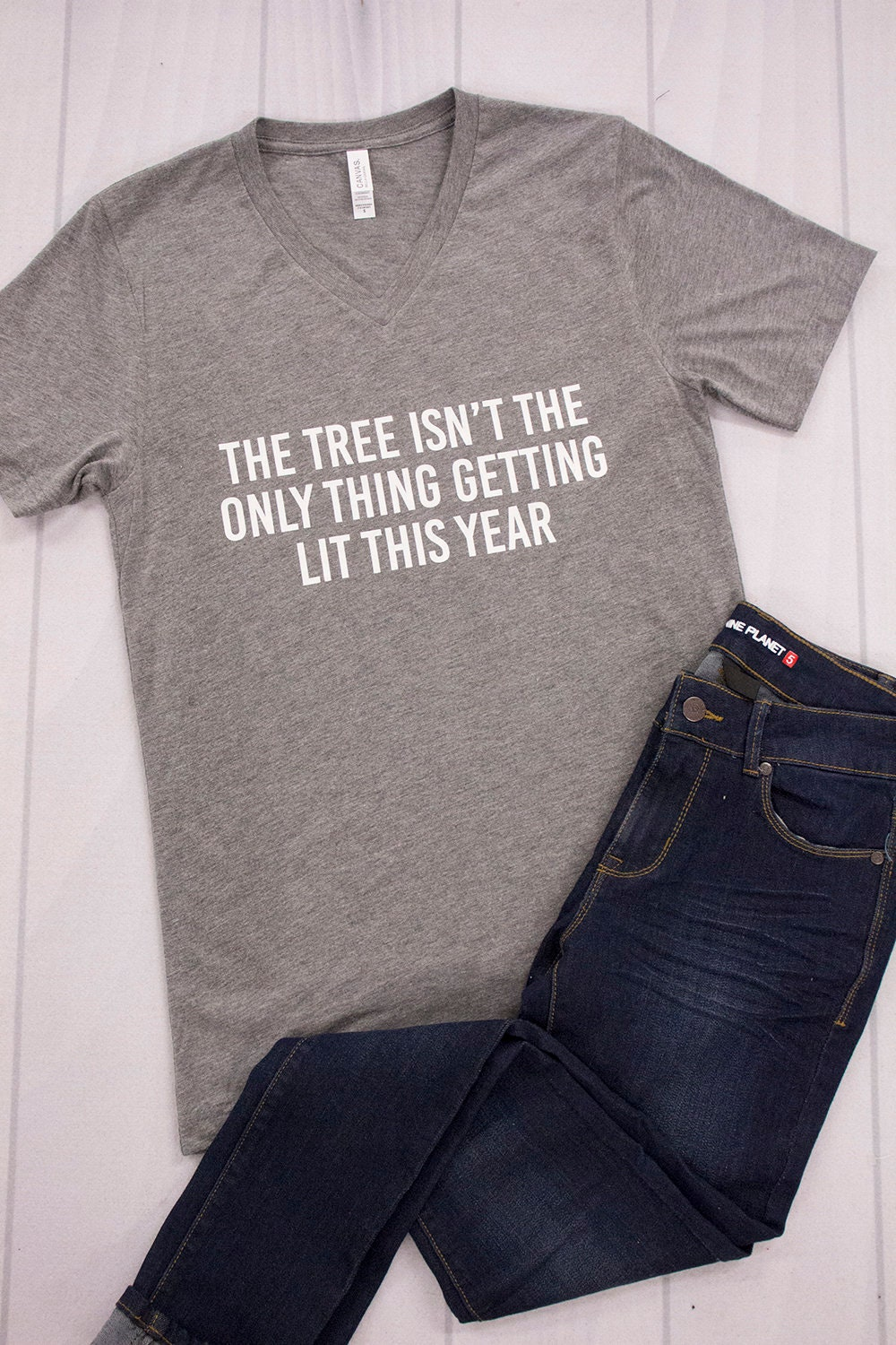 96db60f8610 The Tree Isn t The Only Thing Getting Lit V-Neck Graphic