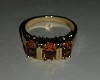 Vintage ring with orange stones.