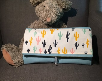 Nomadic changing pouch