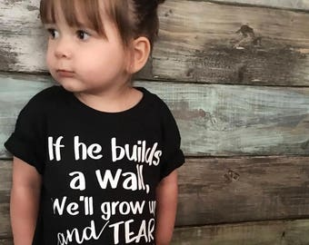 710353198 Build a wall, We'll Tear It Down, Social Justice, immigrants, refugees, no  ban, feminism toddler, baby, feminist, protest