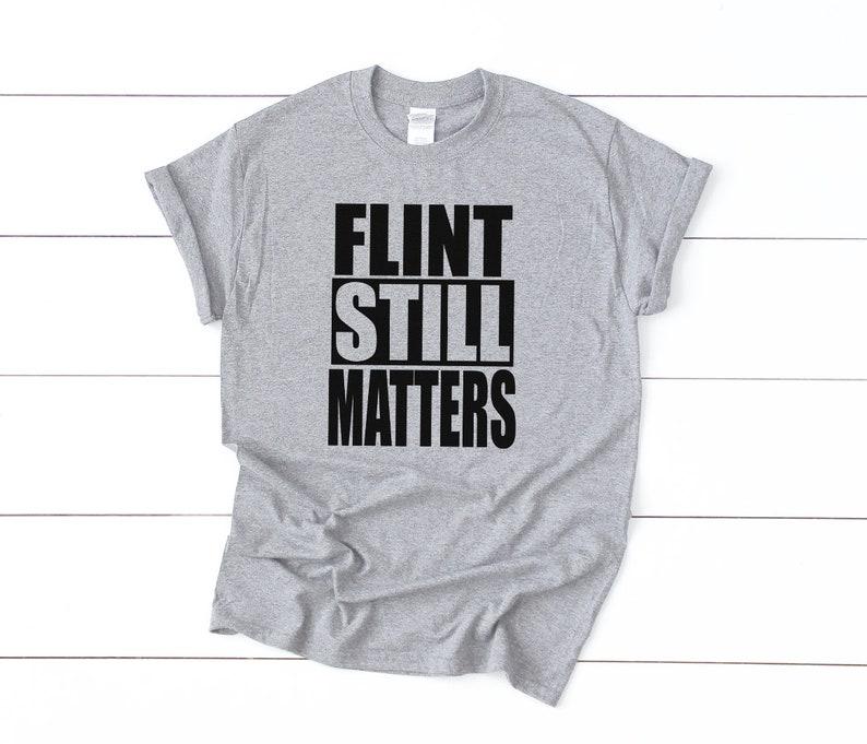 9c6c939c74aa DONATE Flint Still Matters Water Crisis Shirt Tee T-Shirt | Etsy