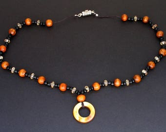 Wood, Black Seed, and Faceted Beaded Necklace with Ring Pendant and Magnetic Clasp