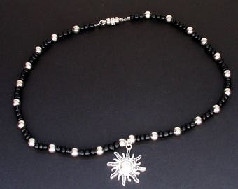 Silver and Black Beaded Necklace with Sun Pendant and Magnetic Clasp