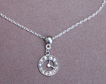 """Silver-plated clock necklace. 9.5 """" chain."""