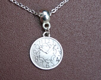 """Silver-plated clock necklace with 8.5"""" chain."""