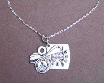 """Silver plated necklace with clock pendant. 9"""" chain."""