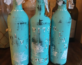 """Set of 3 teal blue antiqued bottles with """"Live with an open heart paintened on them"""""""