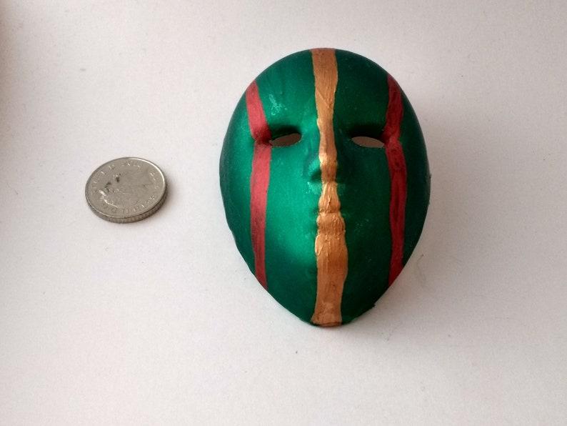Bold festive striped handpainted miniature ceramic mask
