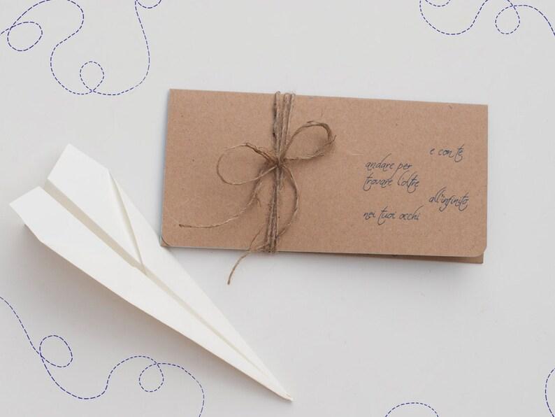 Wedding invitation card for a travel-themed wedding image 0