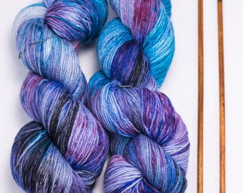 """Hand Dyed Sock Yarn, Variegated Red Pink and Purple, Superwash Merino Wool, Cashmere, and Nylon, Color """"Ilunabarra"""""""