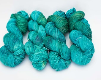 """Hand Dyed Sock Yarn, Variegated Turquoise and Green, Superwash Merino Wool, Cashmere, and Nylon, Color """"Mermaid Scales"""""""